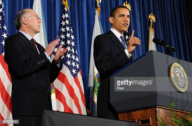 S President Barack Obama speaks as US Secretary of the Interior Ken Salazar looks on during the 160th anniversary ceremony of the Interior Department...