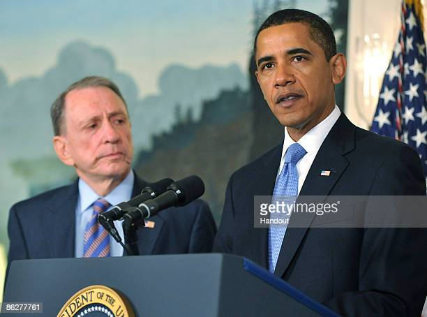 S President Barack Obama speaks as US Sen Arlen Specter listens during a press conference welcoming him to the Democratic Party at the White House on...