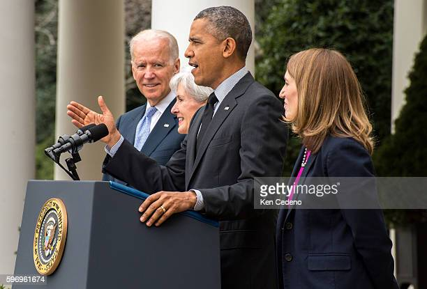 US President Barack Obama speaks as Vice President Joe Biden Health and Human Services Secretary Kathleen Sebelius and Director of the Office of...