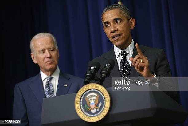President Barack Obama speaks as Vice President Joseph Biden listens during a bill signing ceremony at the South Court Auditorium of the Eisenhower...