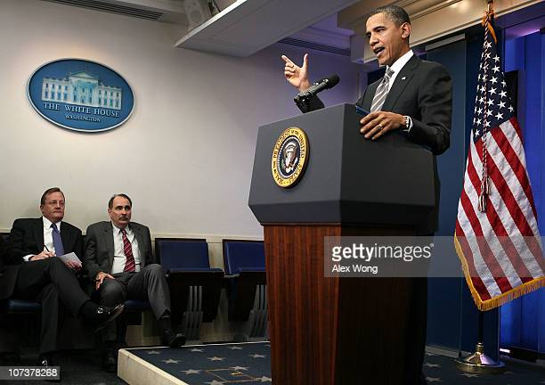 S President Barack Obama speaks as White House Press Secretary Robert Gibbs and senior adviser David Axelrod look on during a news conference at the...