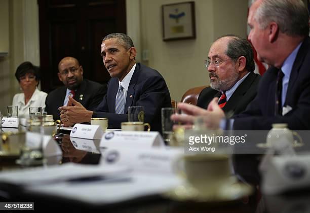 S President Barack Obama speaks as White House senior adviser Valerie Jarrett Philadelphia Mayor Michael Nutter Gabriel Ojeda of FritzPak and Mayor...