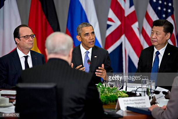 US President Barack Obama speaks as Xi Jinping China's president and Francois Hollande France's president listen during a P51 multilateral meeting at...