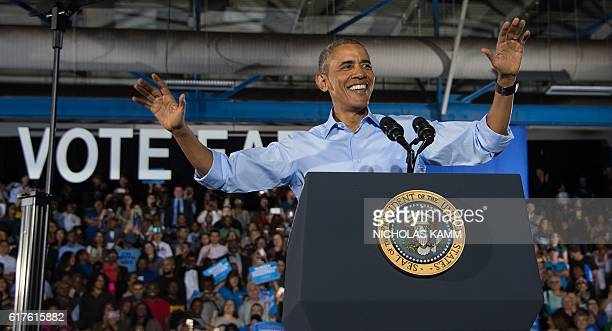 US President Barack Obama speaks at a campaign event for Democratic presidential candidate Hillary Clinton in Las Vegas on October 23 2016 / AFP /...