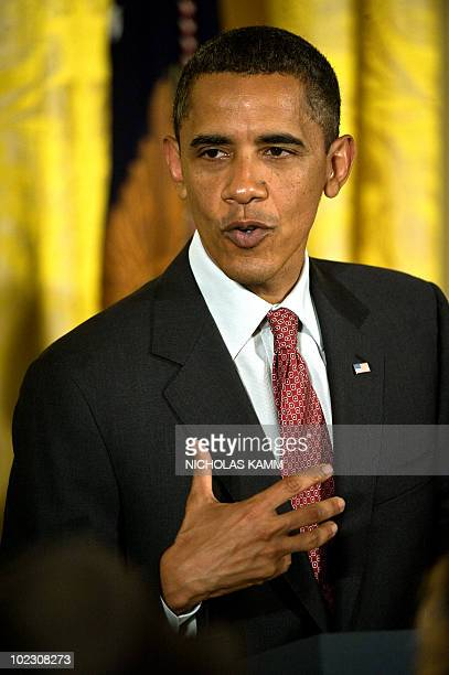 US President Barack Obama speaks at a Lesbian Gay Bisexual and Transgender Pride Month event in the East Room of the White House in Washington on...
