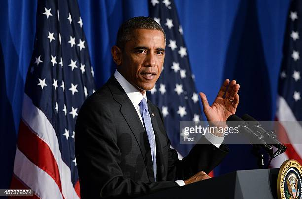 President Barack Obama speaks at the Consumer Financial Protection Bureau on October 17, 2014 in Washington, DC. In his speech, he highlighted steps...