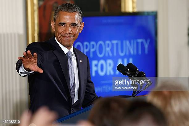 S President Barack Obama speaks before signing an executive order on workplace discrimination July 21 2014 at the White House in Washington DC The...