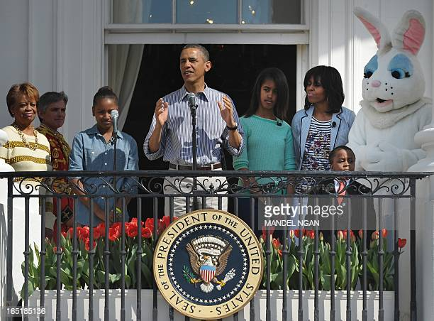 US President Barack Obama speaks before the start of the annual Easter Egg Roll on April 1 2013 at the White House in Washington DC From left are...