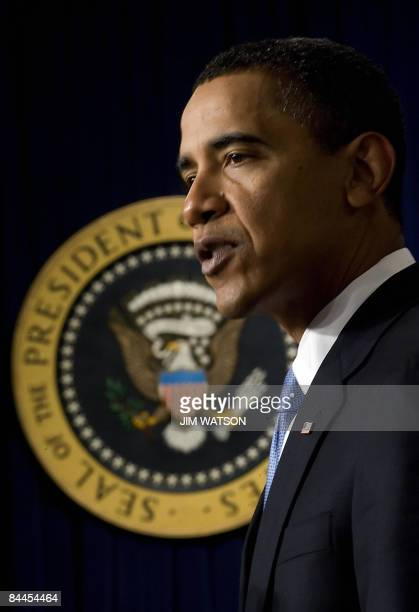 President Barack Obama speaks during a ceremony in the Eisenhower Executive Office Building to swear in his staff in Washington, DC, January 21,...