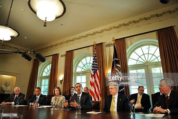 US President Barack Obama speaks during a meeting on financial reform in the Cabinet Room at the White House in Washington DC on April 14 2010 Obama...