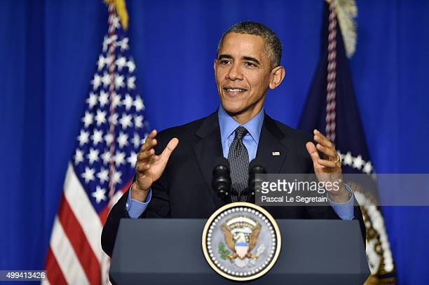 S President Barack Obama speaks during a press conference at the OECD Conference Centre before leaving the Conference On Climate Change COP21 on...