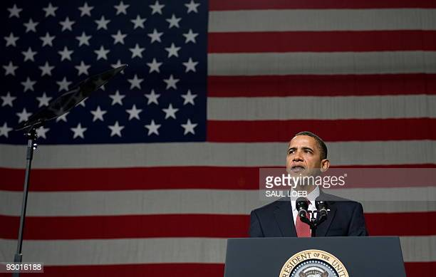 President Barack Obama speaks during a rally with US troops at Elmendorf Air Force Base in Anchorage, Alaska, November 12, 2009. The stopover marks...