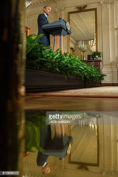 US President Barack Obama speaks during a reception for NASCAR driver Kyle Busch and his team members celebrating Busch's win in the NASCAR Spring...