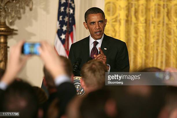 US President Barack Obama speaks during a reception for the lesbian gay bisexual and transgendered community in the East Room of the White House in...