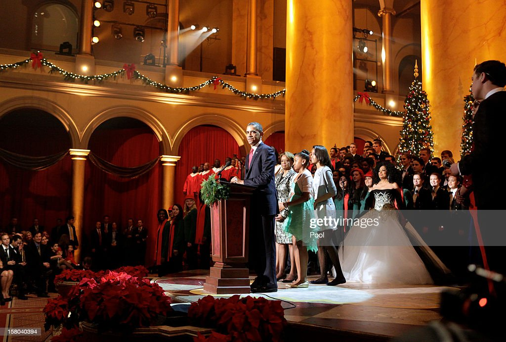 U.S. President Barack Obama (C) speaks during the 'Christmas in Washington' concert with first lady Michelle Obama and daughters Malia and Sasha Obama at the National Building Museum on December 9, 2012 in Washington, D.C. The concert benefits the National Childrens Medical Center and is hosted by comedian Conan O'Brien.