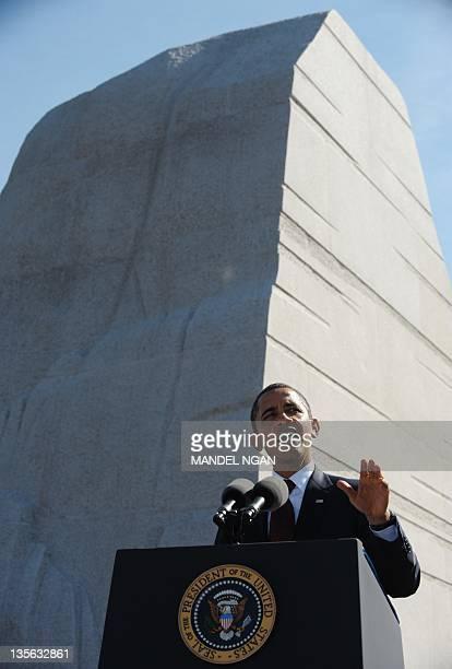 US President Barack Obama speaks during the dedication of the Martin Luther King Jr Memorial October 16 2011 in Washington DC Obama hailed the 'moral...