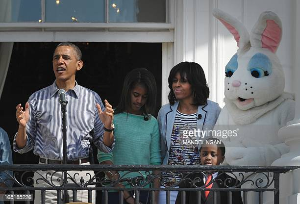 US President Barack Obama speaks during the start of the annual Easter Egg Roll on April 1 2013 at the White House in Washington DC From left are...