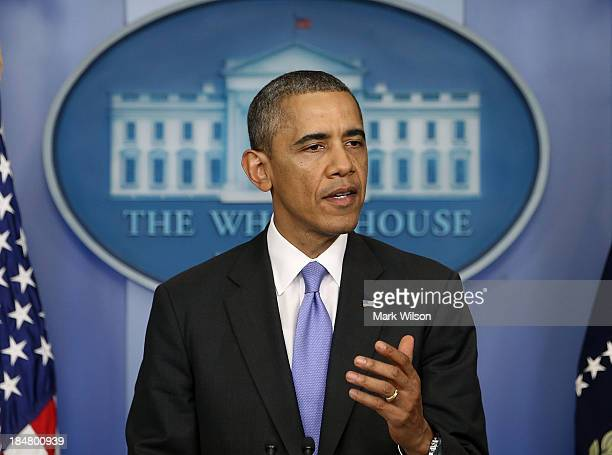 S President Barack Obama speaks in the Brady Press Briefing Room at the White House after the US Senate voted to end the government shutdown and...