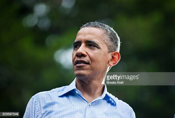 US President Barack Obama speaks in the rain during a campaign rally in Glen Allen Virginia