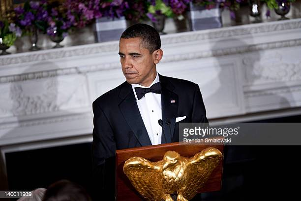 US President Barack Obama speaks in the State Dining Room of the White House February 26 2012 in Washington DC President Obama and first lady...