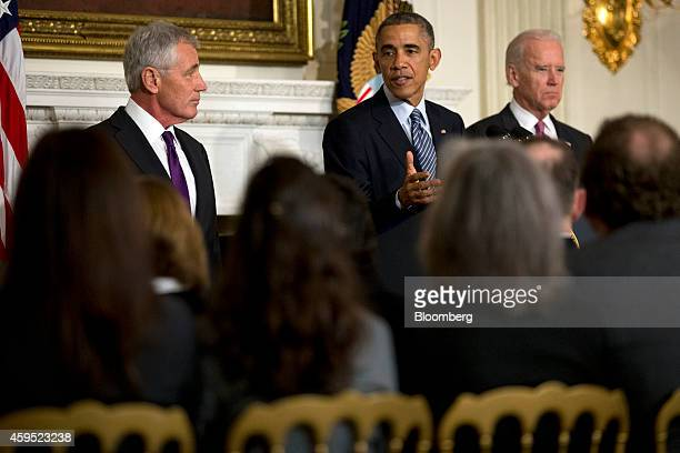 US President Barack Obama speaks in the State Dining Room of the White House with Chuck Hagel US secretary of defense left and US Vice President...