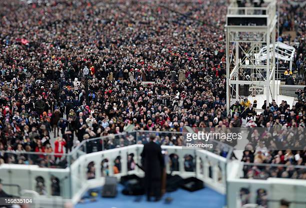 US President Barack Obama speaks in this photo taken with a tilt shift lens during the presidential inauguration in Washington DC US on Monday Jan 21...