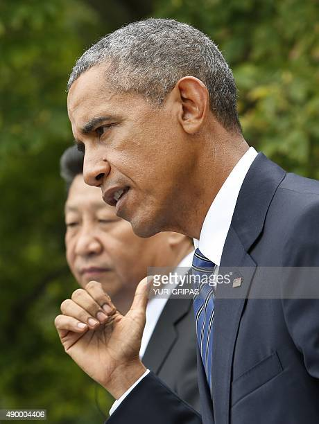 US President Barack Obama speaks next to Chinese President Xi Jinping at a joint press conference after their meeting at the White House in...