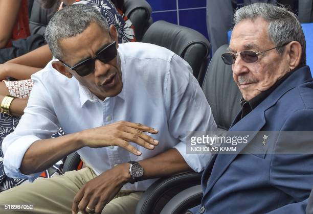 US President Barack Obama speaks next to Cuban President Raul Castro during a Major League baseball exhibition game between the Tampa Bay Rays and...