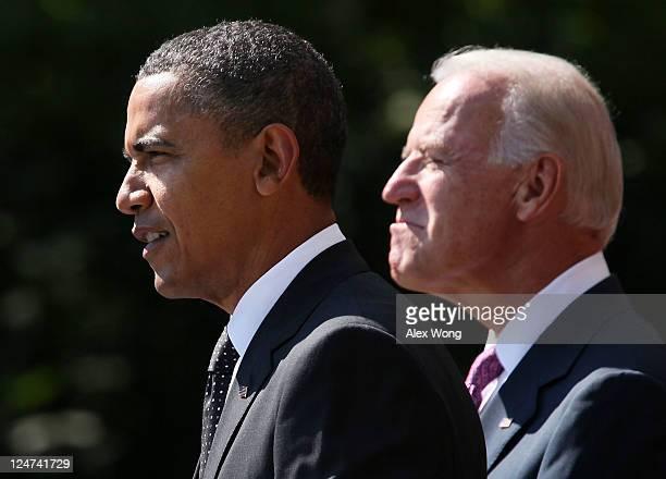 S President Barack Obama speaks on his $400 billion jobs plan he is sending to Congress as Vice President Joseph Biden listens during a Rose Garden...