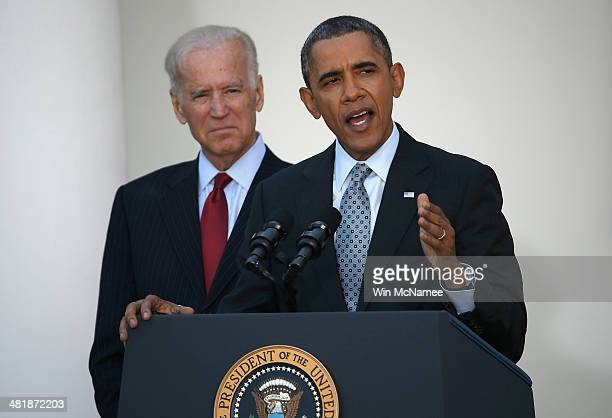 S President Barack Obama speaks on the Affordable Care Act with Vice President Joe Biden in the Rose Garden of the White House April 1 2014 in...