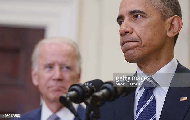 US President Barack Obama speaks on the Keystone XL pipeline watched by Vice President Joe Biden on November 6 2015 in the Roosevelt Room of the...