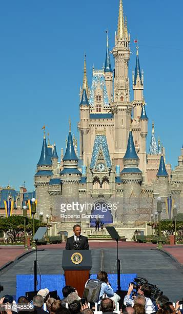 S President Barack Obama speaks to a crowd of supporters at Walt Disney World's Magic Kingdom with Cinderella Castle in the background January 19...
