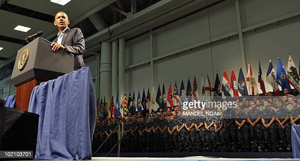 US President Barack Obama speaks to military personnel at the Naval Air Technical Training Center of the Pensacola Naval Air Station June 15 2010 in...