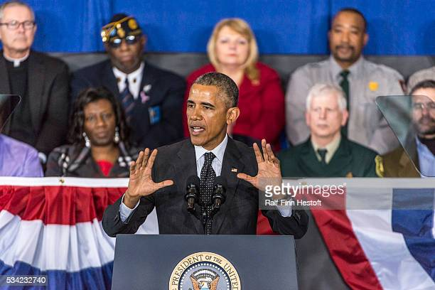 President Barack Obama speaks to the crowd at Gwendolyn Brooks College Prep on the South Side of Chicago Illinois In addition to speaking the...