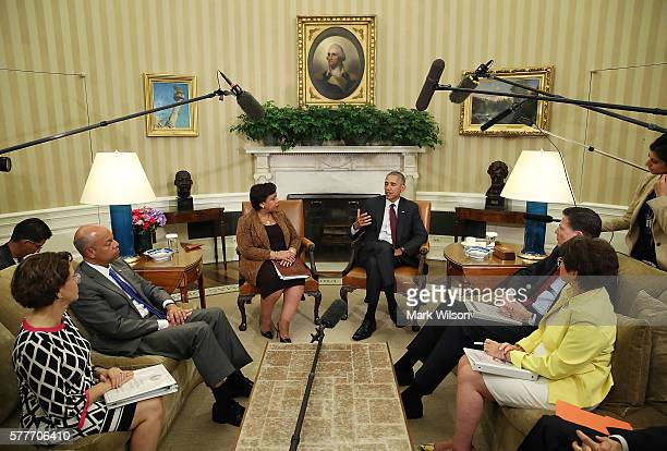 S President Barack Obama speaks to the media as White House Domestic Policy Council Cecilia Munoz Homeland Security Secretary Jeh Johnson Attorney...