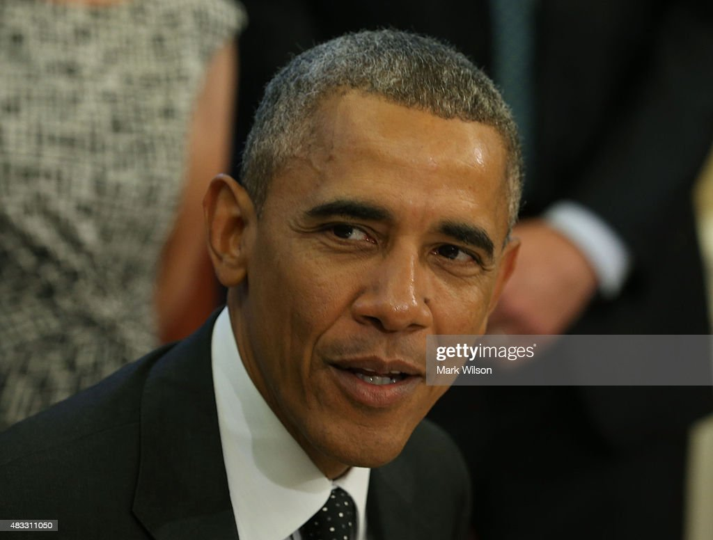 US President Barack Obama speaks to the media before signing the H.R. 1138 Sawtooth National Recreation Area and Jerry Peak Wilderness Additions Act. in the Oval Office at the White House, August 7, 2015 in Washington, DC. Later today President Obama and his family will be departing for a two week vacation on Martha's Vineyard in Massachusetts.