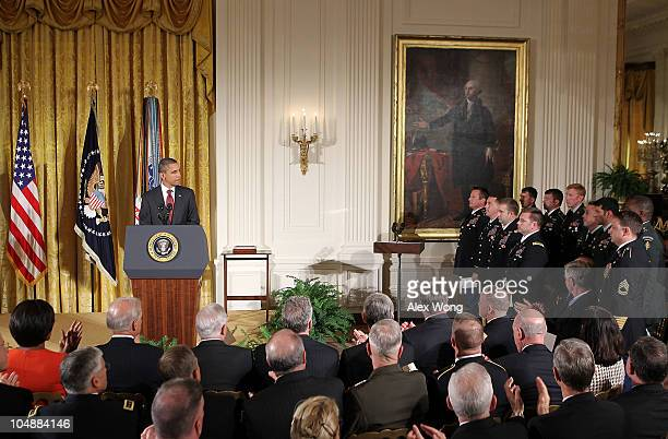 S President Barack Obama speaks to the team members of late Army Staff Sergeant Robert J Miller during an East Room presentation ceremony of a Medal...