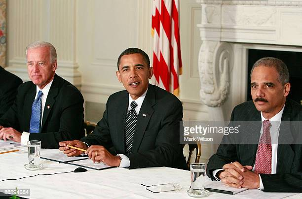 President Barack Obama speaks while Attorney General Eric Holder and Vice President Joseph Biden listen during a Cabinet meeting at the White House...