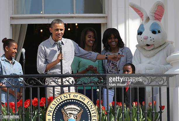 S President Barack Obama speaks while flanked by his daughters Sasha Malia first lady Michelle Obama Robby Novak and the Easter Bunny during the...