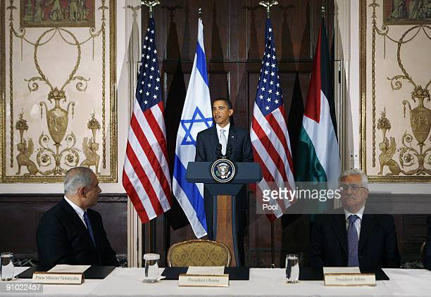 S President Barack Obama speaks while Israeli Prime Minister Benjamin Netanyahu and Palestinian President Mahmoud Abbas during a trilateral meeting...