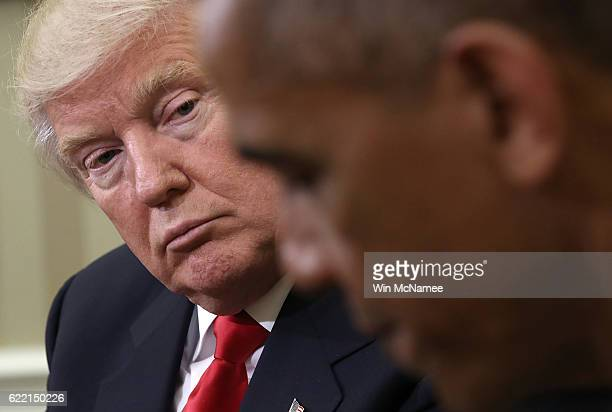 S President Barack Obama speaks while meeting with Presidentelect Donald Trump following a meeting in the Oval Office November 10 2016 in Washington...