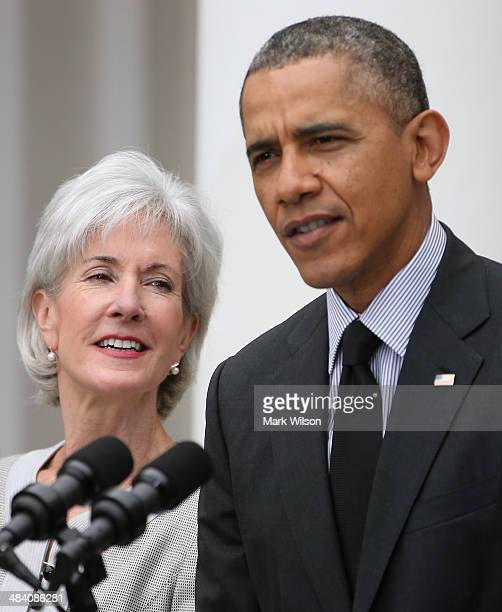S President Barack Obama speaks while outgoing Health and Human Services Secretary Kathleen Sebelius listens during an event in the Rose Garden at...