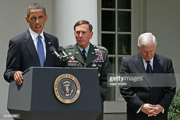 President Barack Obama speaks while US General David Petraeus and Secretary of Defense Robert Gates listen in the Rose Garden at the White House on...