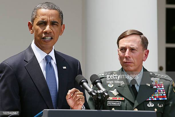 S President Barack Obama speaks while US General David Petraeus looks on in the Rose Garden at the White House on June 23 2010 in Washington DC...