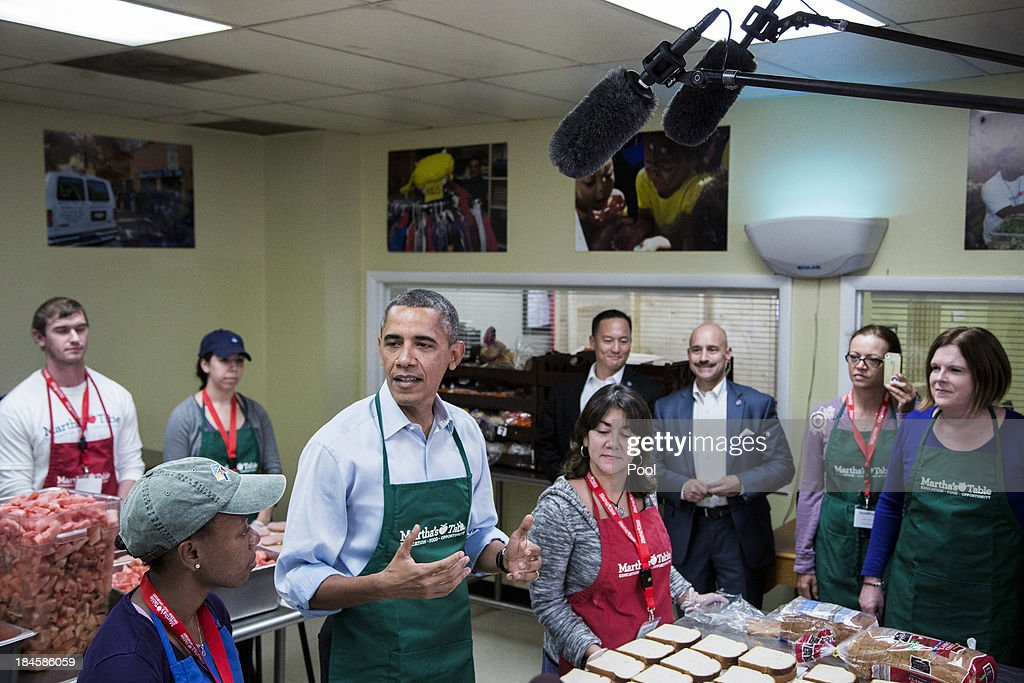 U.S. President Barack Obama speaks while visiting with furloughed federal workers volunteering at a Martha's Table kitchen on October 14, 2013 in Washington, D.C. During a statement, Obama called on congress to end the budget stalemate and allow federal employees to return to work.