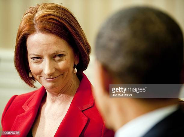US President Barack Obama speaks with Australian Prime Minister Julia Gillard during a bilateral meeting in the Oval Office of the White House in...