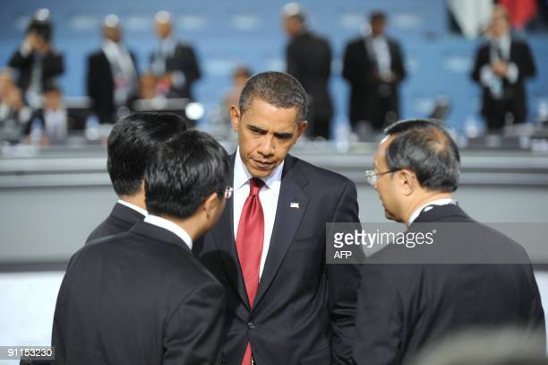 President Barack Obama speaks with Chinese President Hu Jintao during the morning G-20 plenary session at the Pittsburgh Convention Center in...
