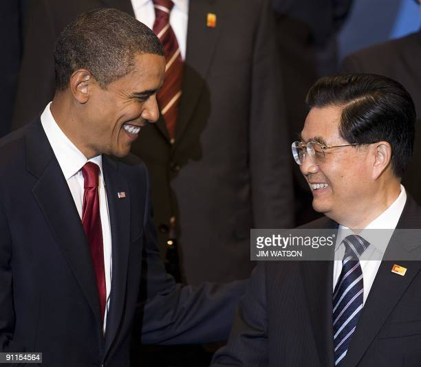 President Barack Obama speaks with Chinese President Hu Jintao during a group photo at the G20 summit in Pittsburgh on September 25, 2009. AFP...