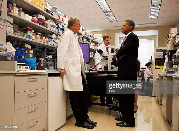 US President Barack Obama speaks with Dr Francis Collins and Dr Marston Linehan during a laboratory tour with Health and Human Services Secretary...