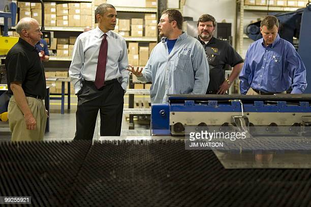 US President Barack Obama speaks with employees as he tours through Industrial Support Inc before making a speech on the economy in Buffalo New York...